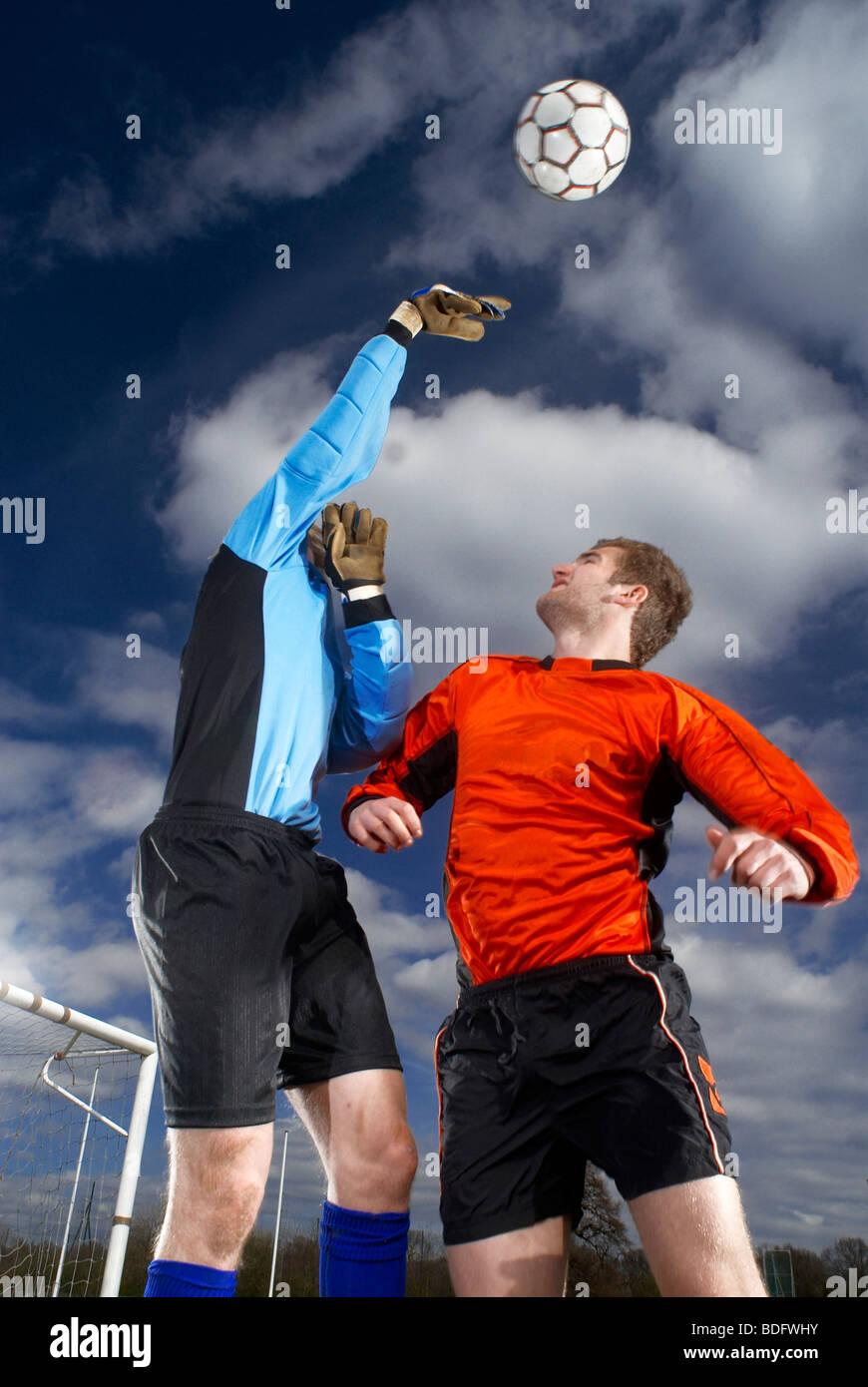 goalkeeper punching ball - Stock Image