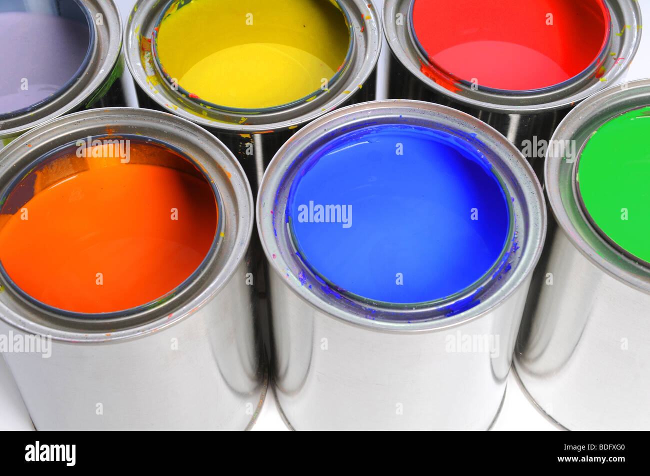 Open cans of paint in close up view - Stock Image