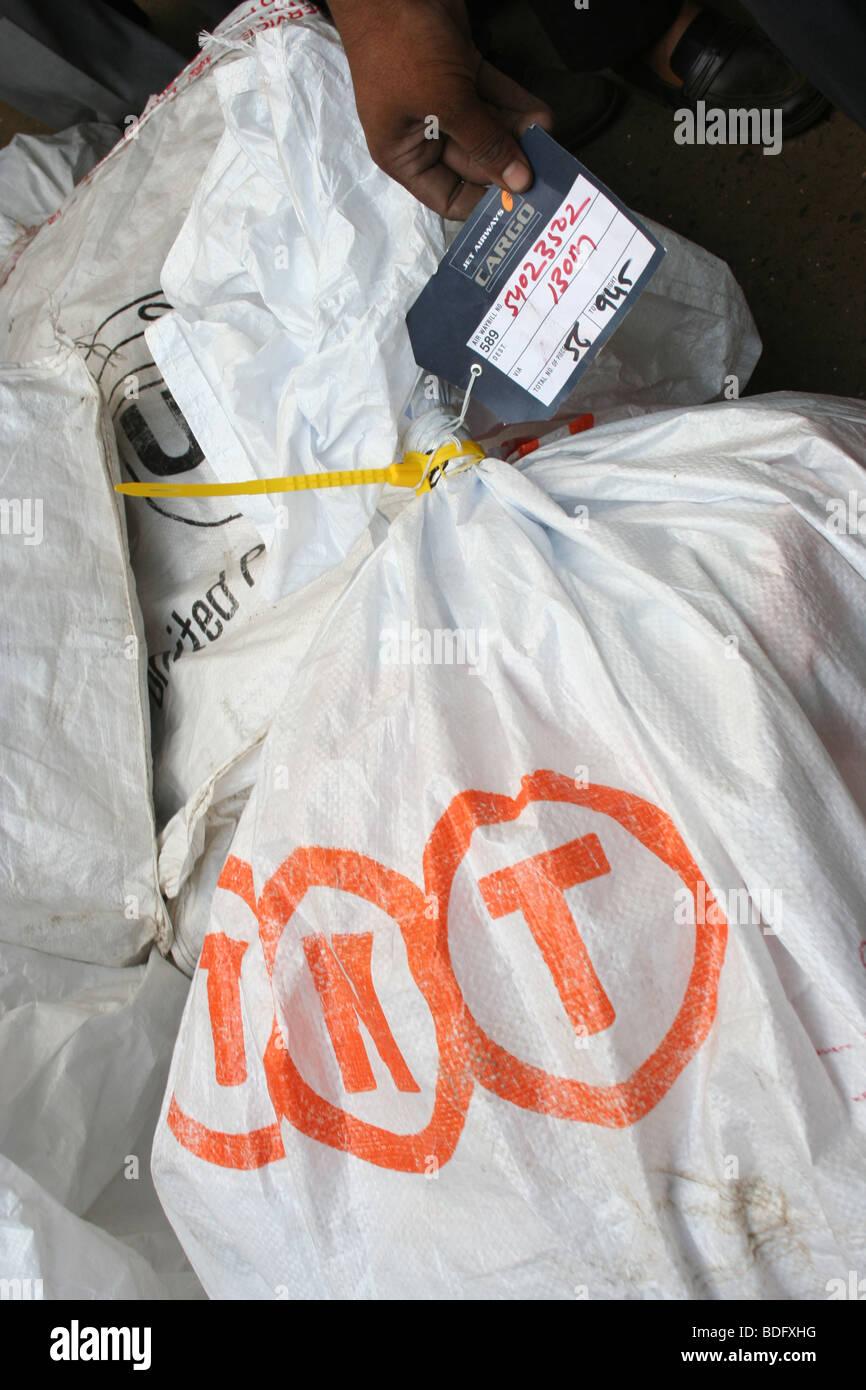 TNT logistics freight air cargo bag Mumbai Airport - Stock Image