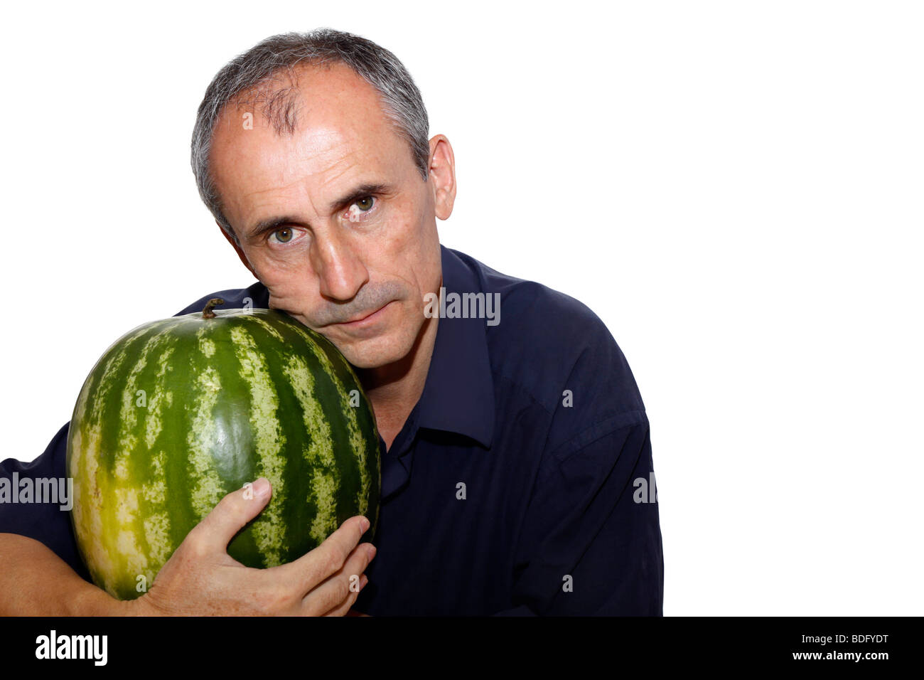 the person has strong pressed to itself a water-melon Stock Photo