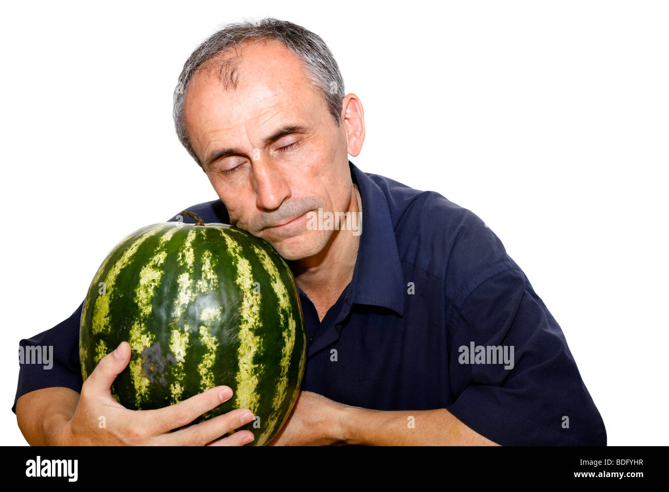 the person has closed eyes from pleasure of that it has a water-melon Stock Photo