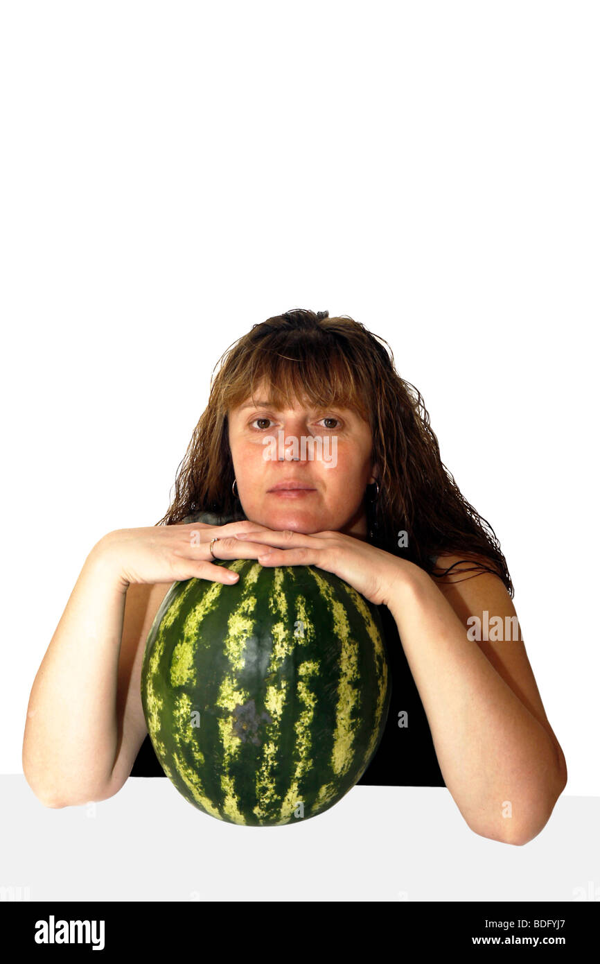 the woman with a water-melon and wet hair, attentively looks forward Stock Photo
