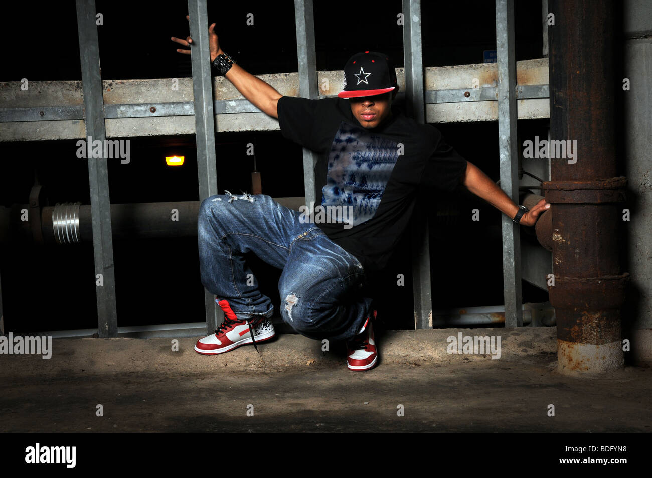 African American hip hop dancer performing in old building Stock Photo