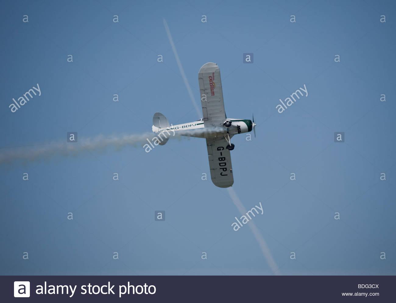 a stunt plane doing his acrobatics - Stock Image