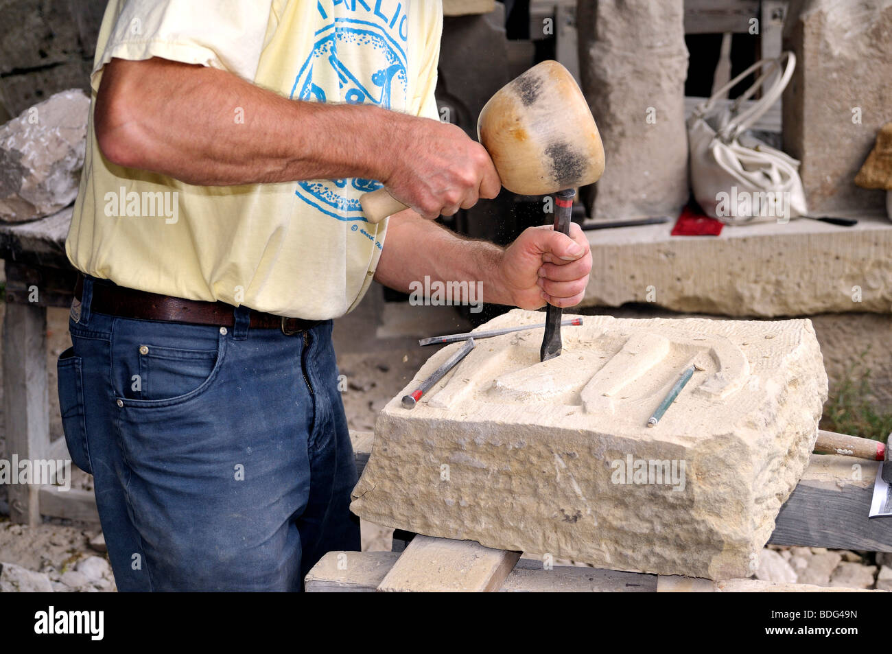 Sculptor working on a stone Stock Photo
