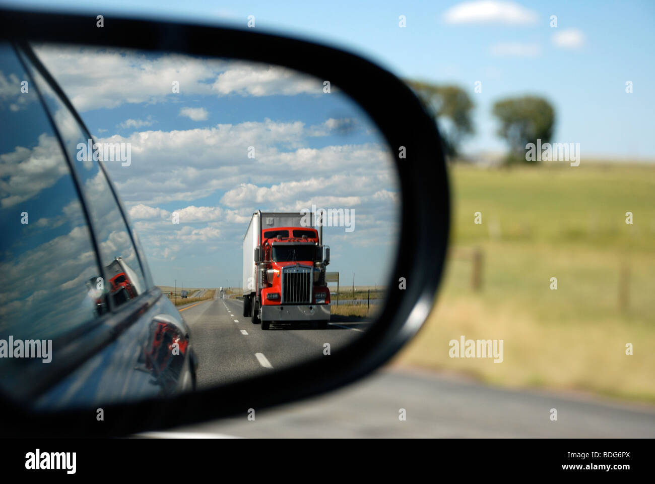 Truck in rear view mirror - Stock Image