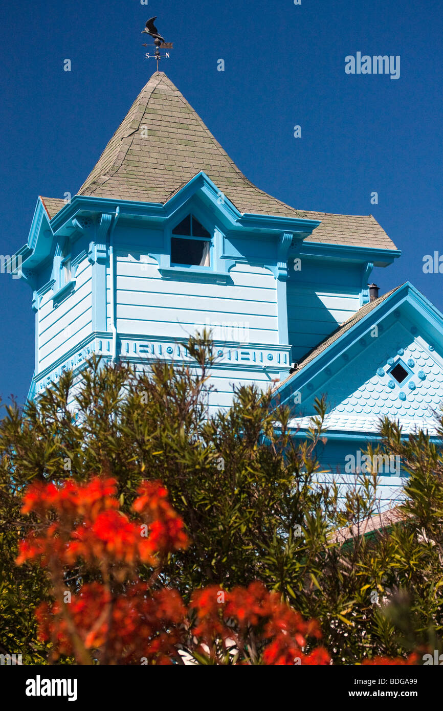 Detail of an entirely blue Victorian home topped by a weather vane in Berkeley, California. - Stock Image