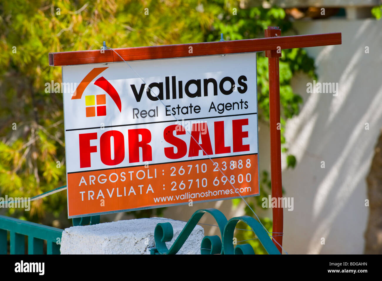 Real Estate Agents for sale board outside house at Assos on