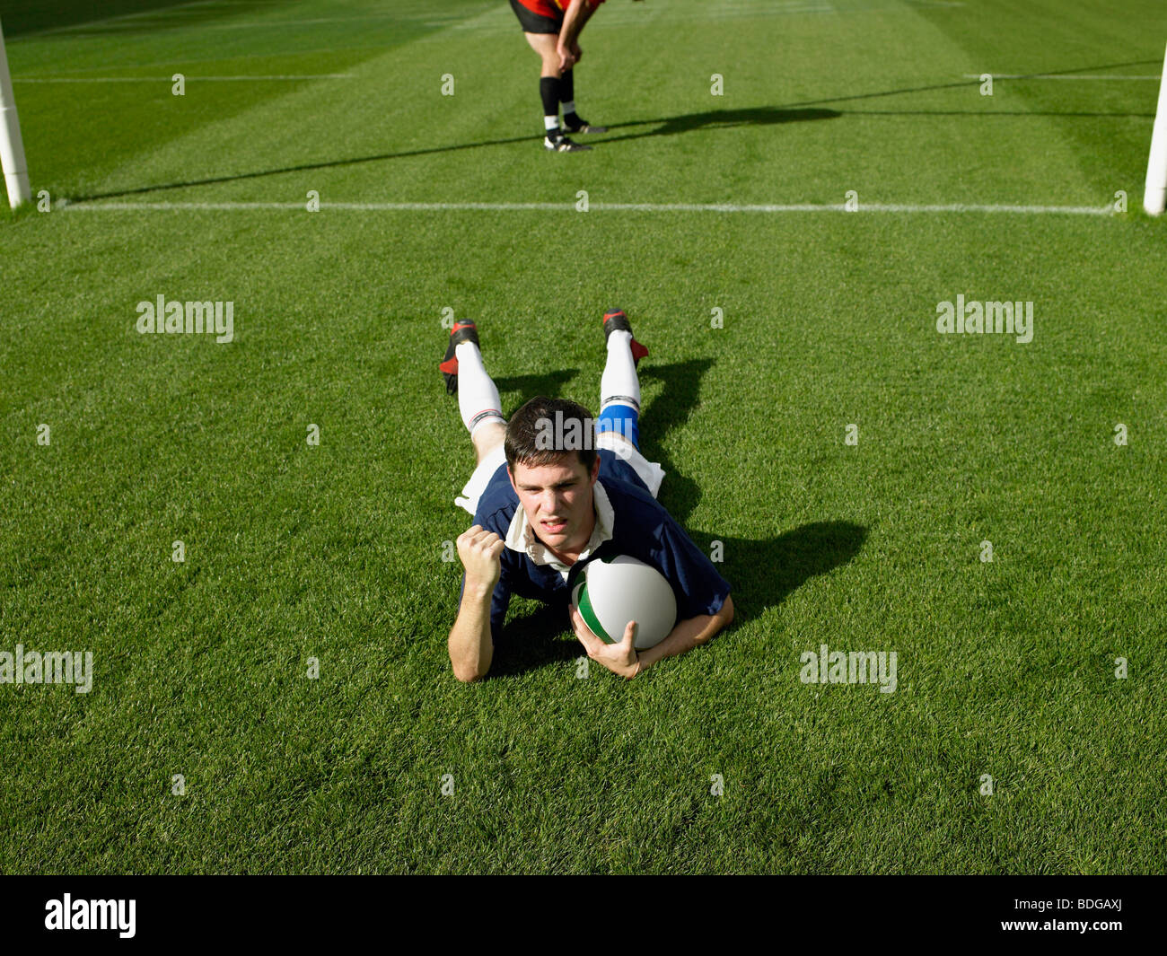 Rugby player scoring a try - Stock Image