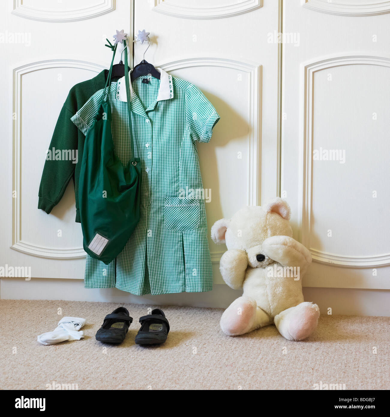 First day of school with upset teddy bear. - Stock Image