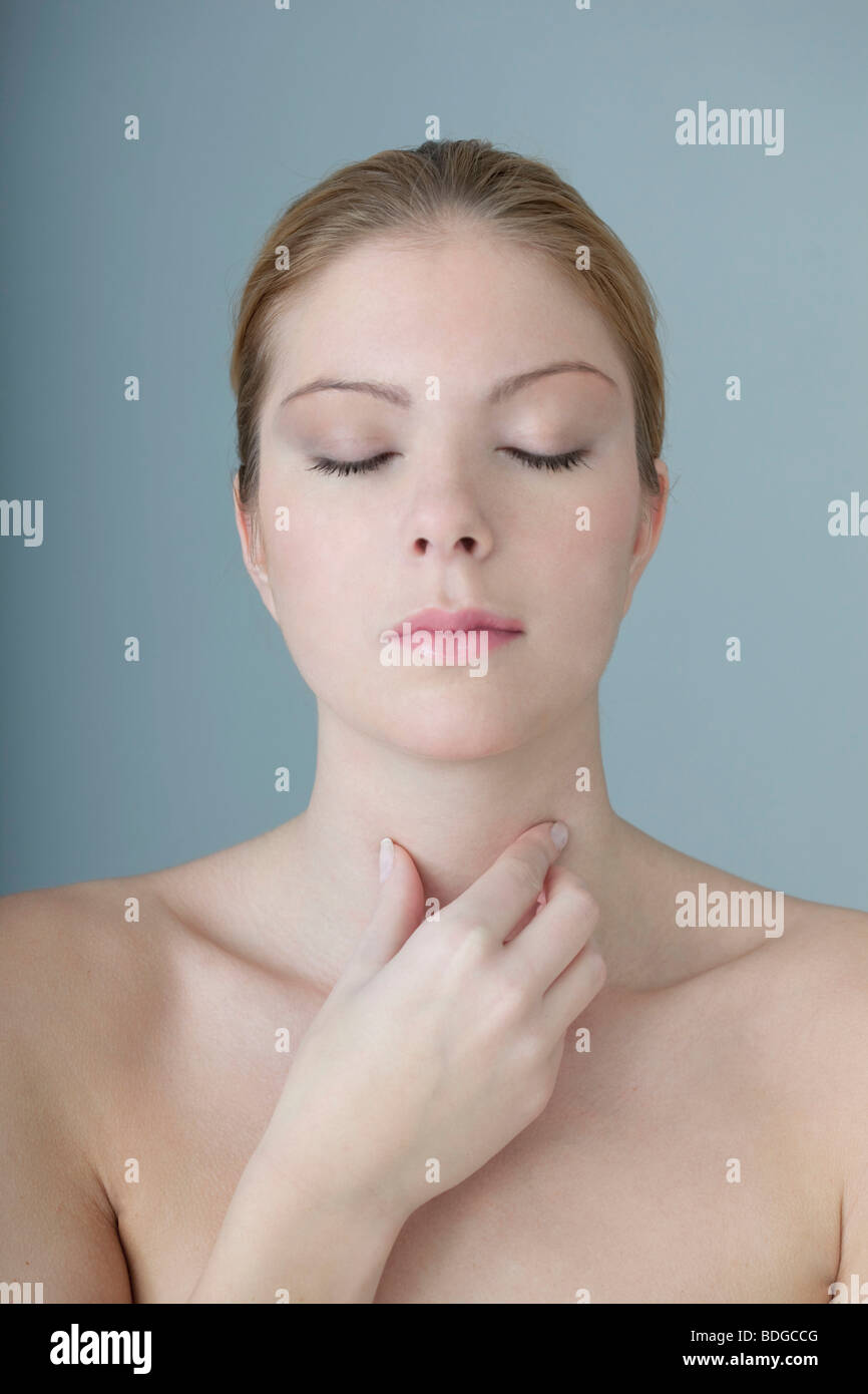 WOMAN WITH SORE THROAT - Stock Image