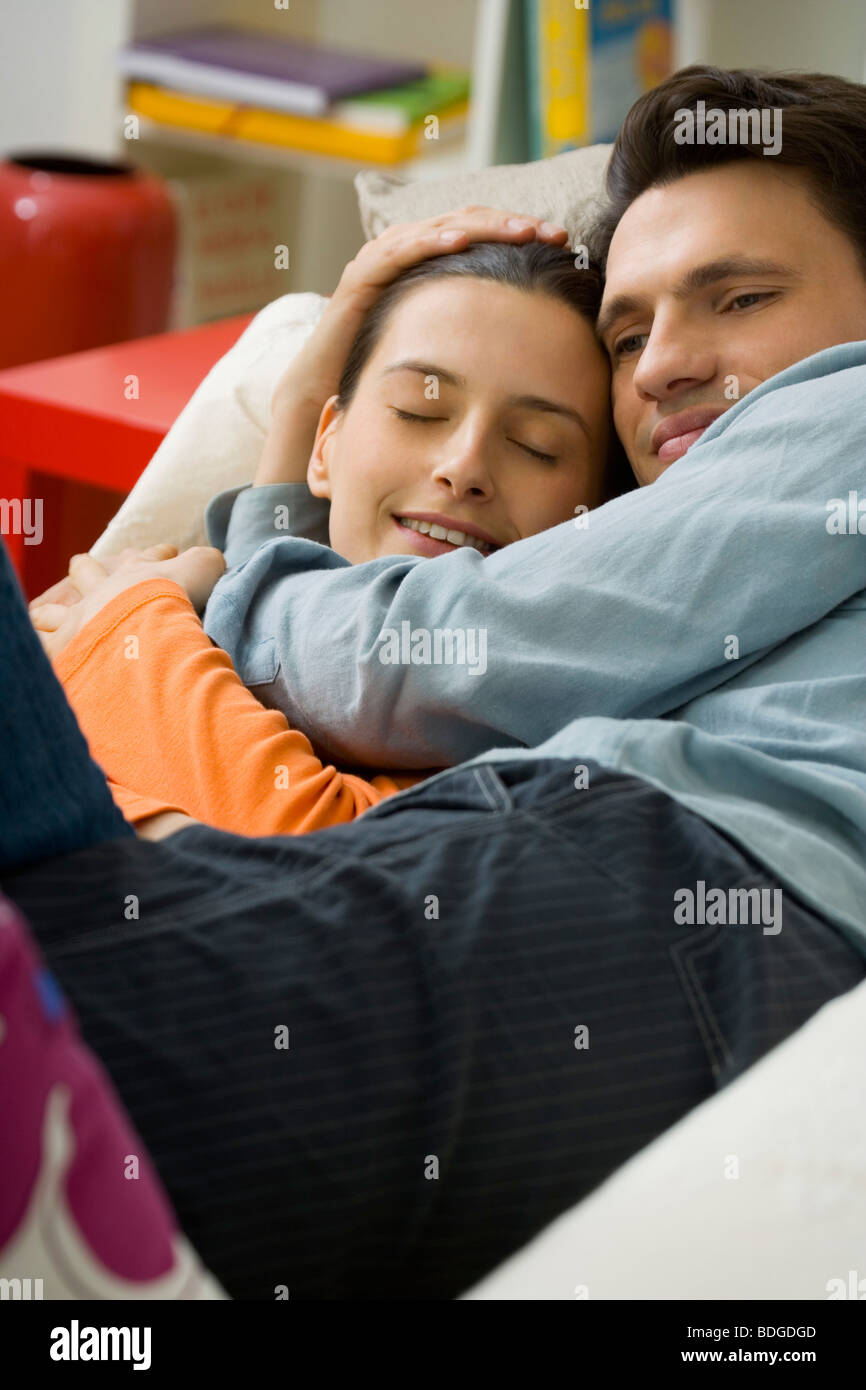 COUPLE IN THEIR 20S, INSIDE - Stock Image