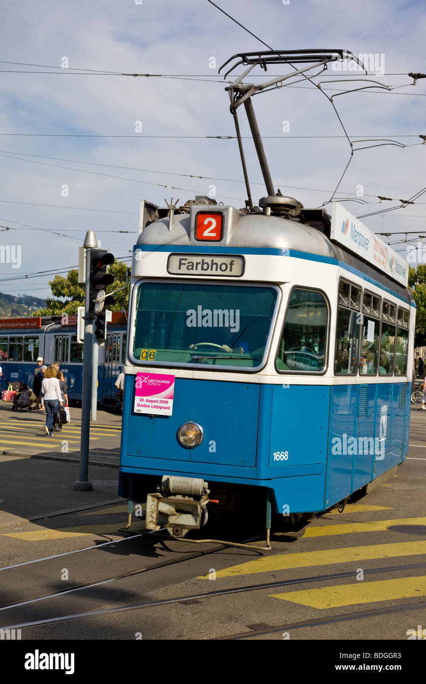 Vintage Zurich tram with cantonal white and blue colours taking the curve onto Bahnhofstrasse - Stock Image