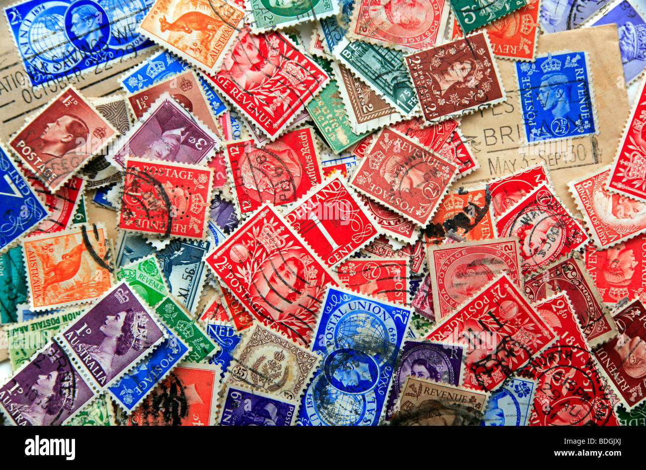 An assortment of used postage stamps for stamp collecting. - Stock Image
