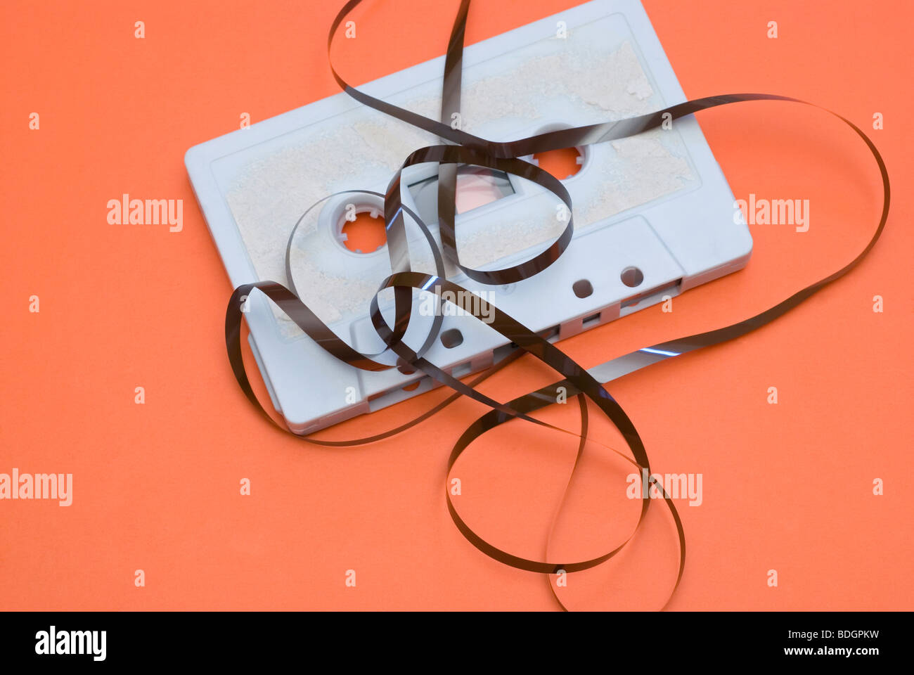 old audio cassette tape spilling out - Stock Image