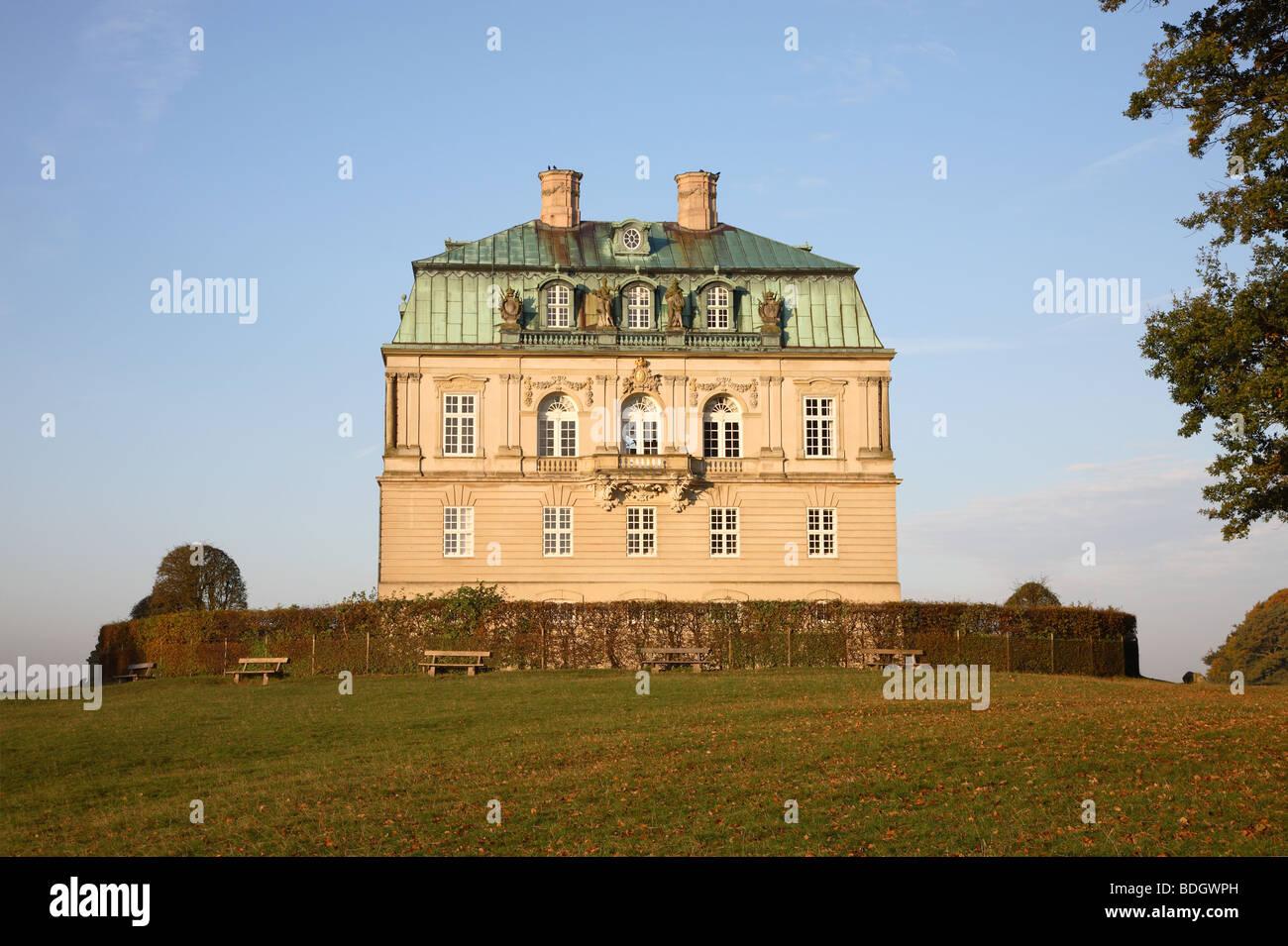 The Hermitage Palace at sunset (Eremitageslottet) in Jægersborg deer park, Dyrehaven,  north of Copenhagen, - Stock Image