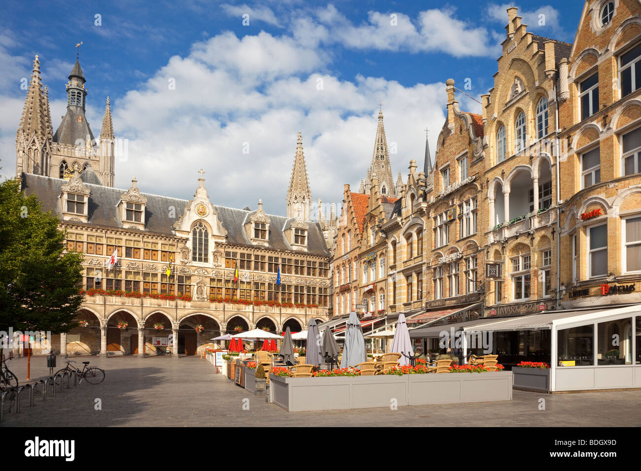 Cafes near the Cloth Hall in Ypres town centre Belgium Europe - Stock Image
