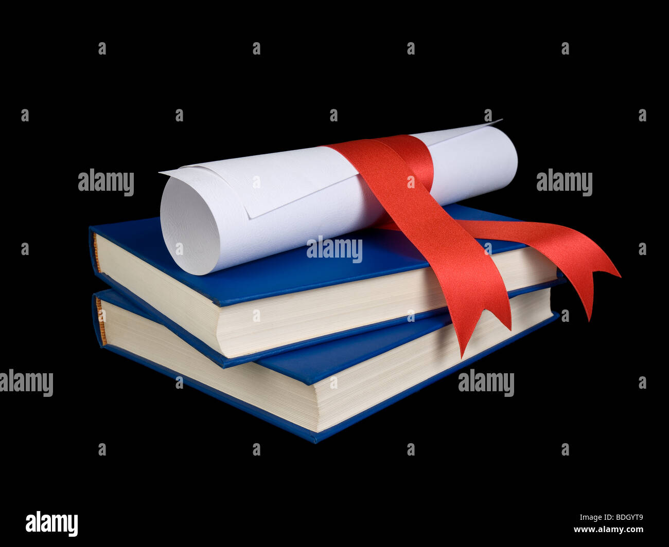A diploma with red ribbon over blue books. - Stock Image