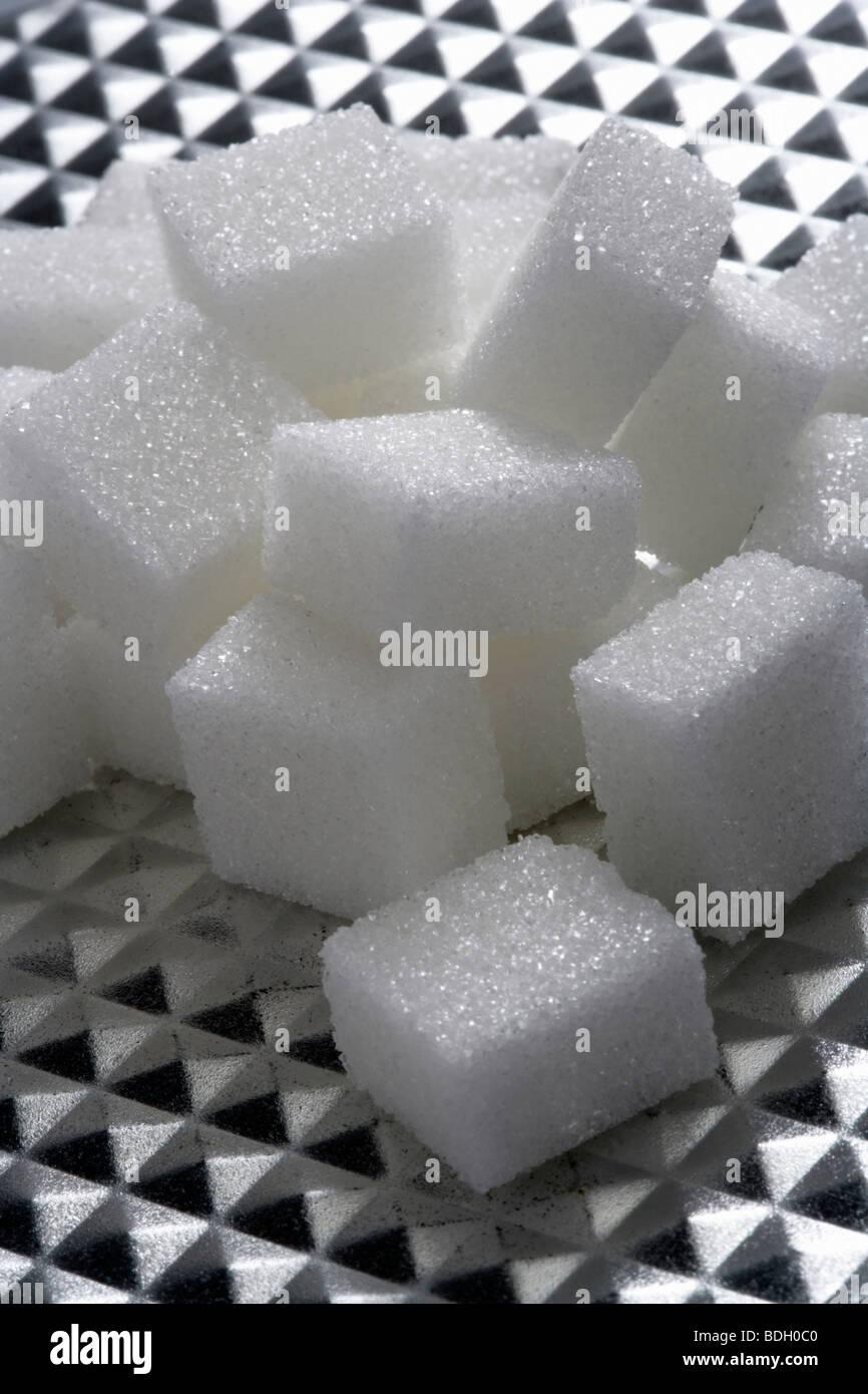 Sugar cube on high-grade steel reductors - Stock Image