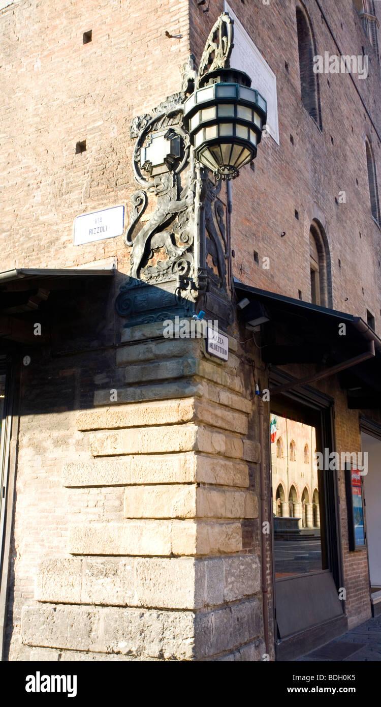 Ancient Street light at the corner of Via Rizzoli and Piazza Del Nettuno in Bologna, Emilia-Romania, Italy - Stock Image