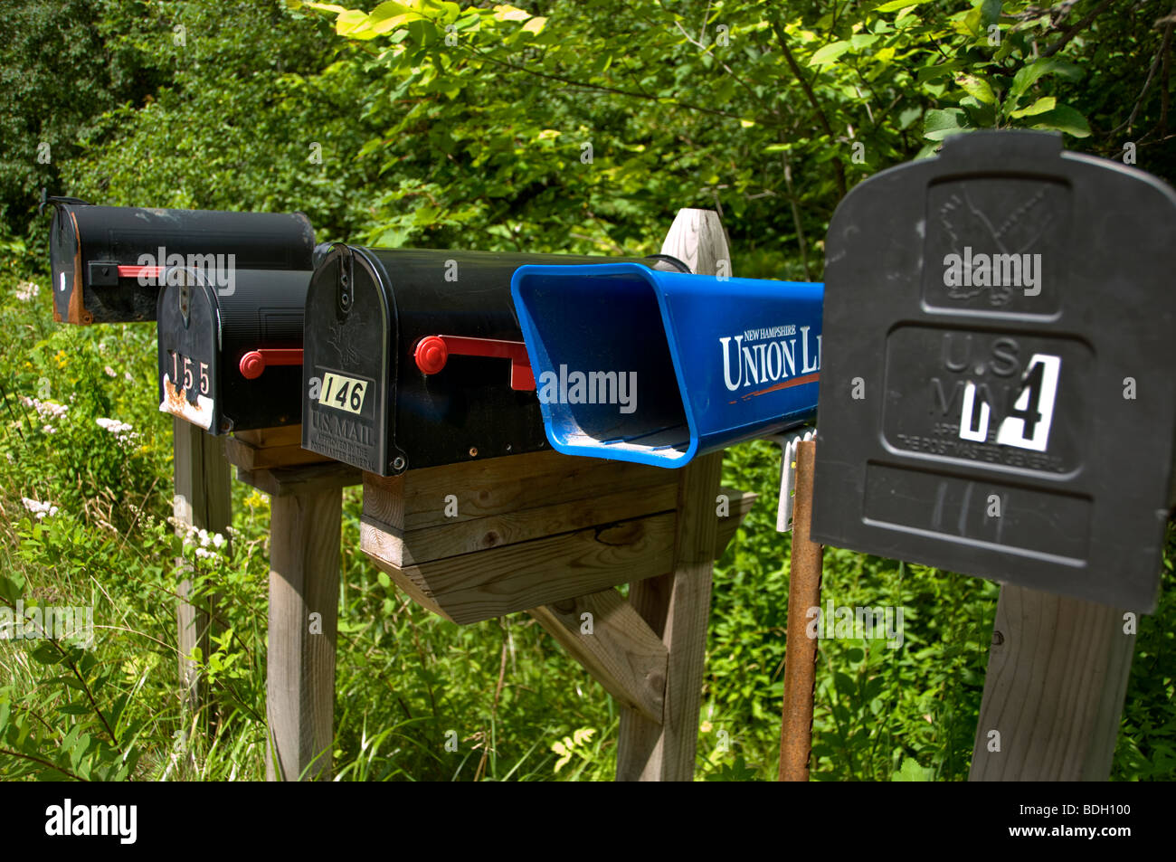 A row of US mailboxes by the roadside in Vermont - Stock Image