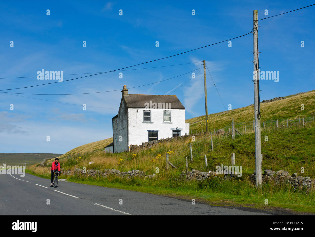 Cyclist in Upper Teesdale, County Durham, England UK - Stock Image