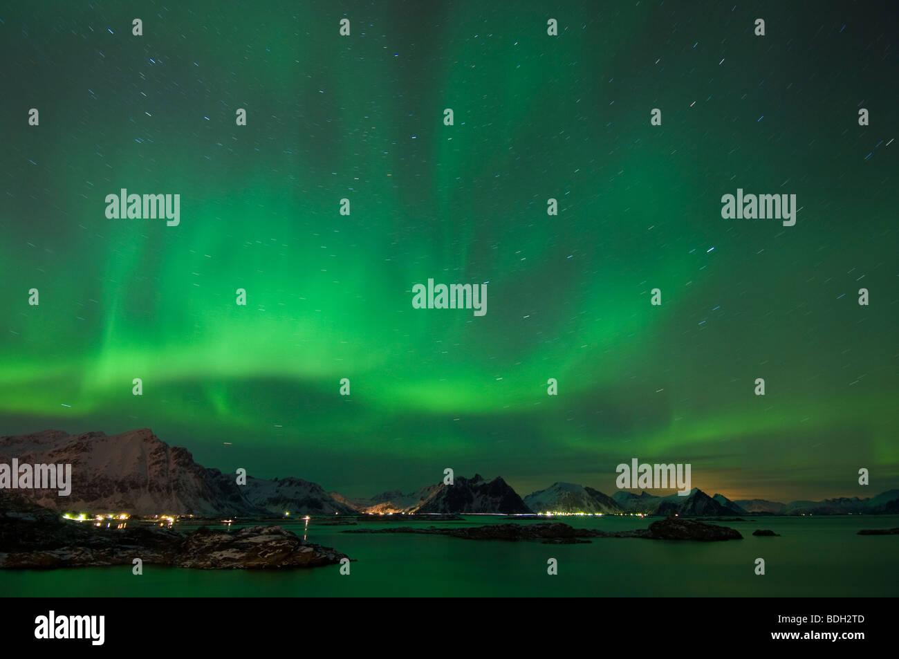 Northern lights shine above mountain peaks of Lofoten Islands, Looking north from Stamsund, Vestvågøy, - Stock Image