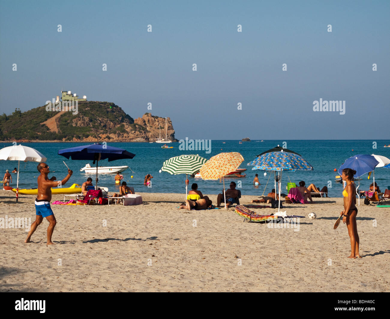 Holidaymakers playing games on Tertenia Beach - Stock Image
