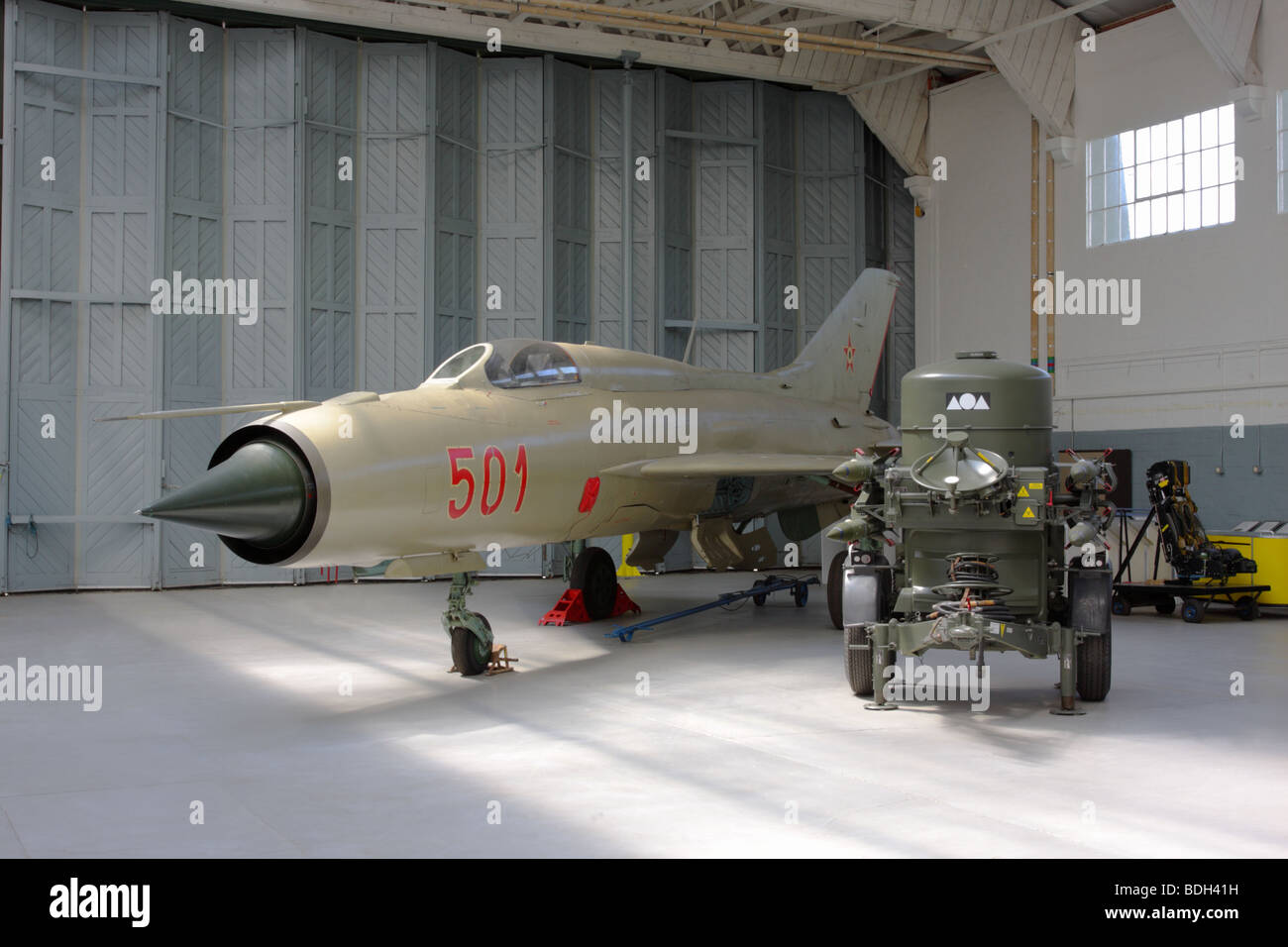 The Mikoyan-Gurevich MiG-21PF jet fighter,currently on permanent display in Hangar 4,IWM Duxford,England. - Stock Image