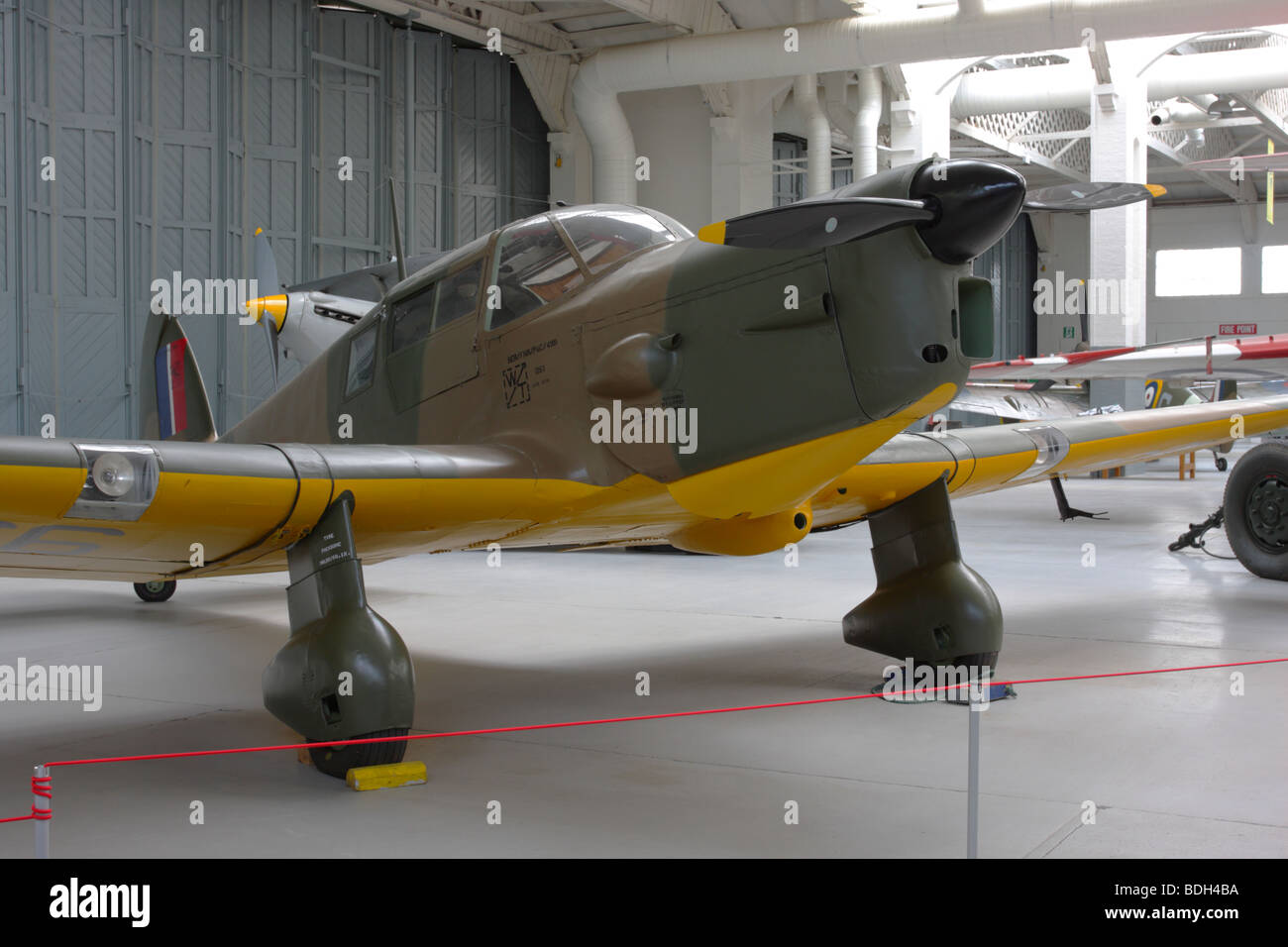In it`s upper camouflage and yellow under belly livery,this example of an Percival Proctor III aircraft at IWM Duxford. - Stock Image
