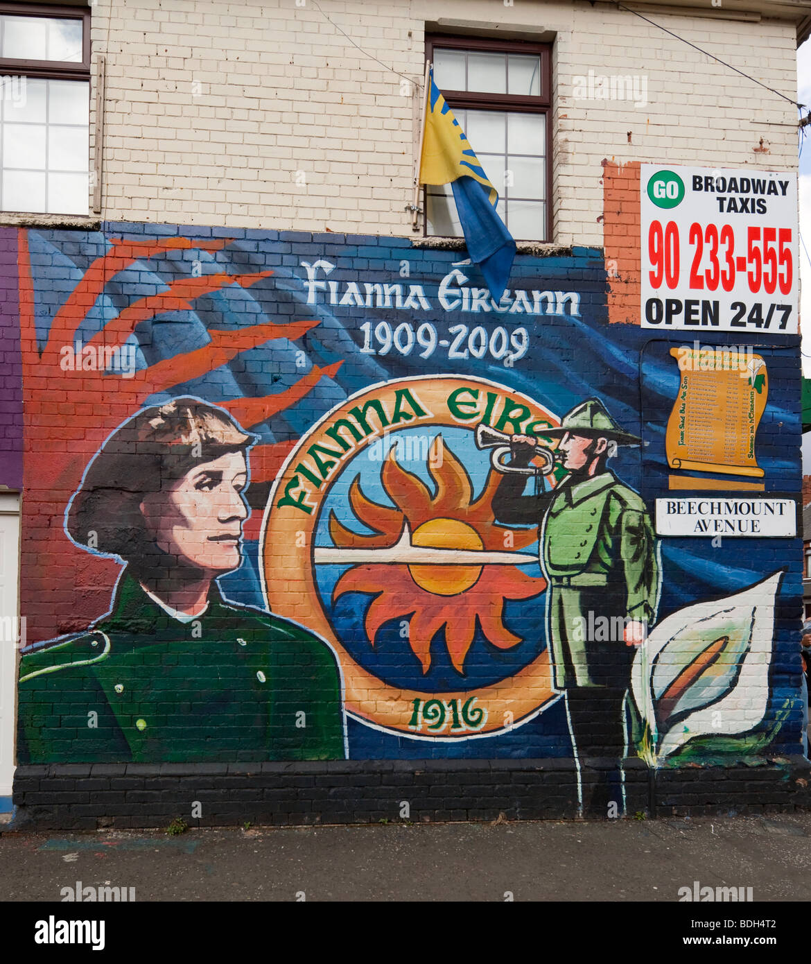 painted gable with ',Fianna Éireann,' Warriors of Ireland, Beechmount Avenue, Falls Road, Belfast, - Stock Image