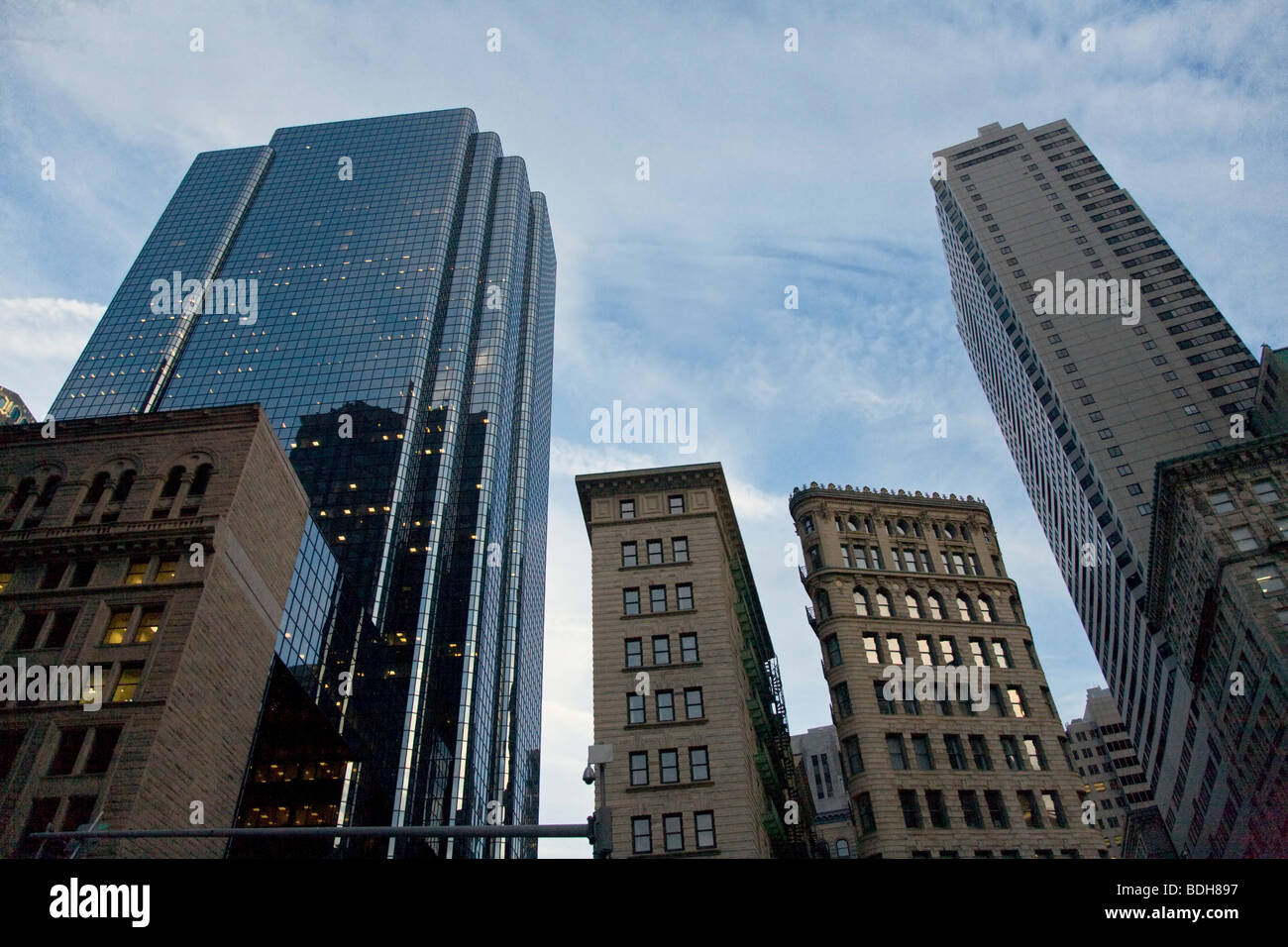 Old Colonial BRICK BUILDINGS are dwarfed by modern SKY SCRAPERS - BOSTON, MASSACHUSETTS - Stock Image
