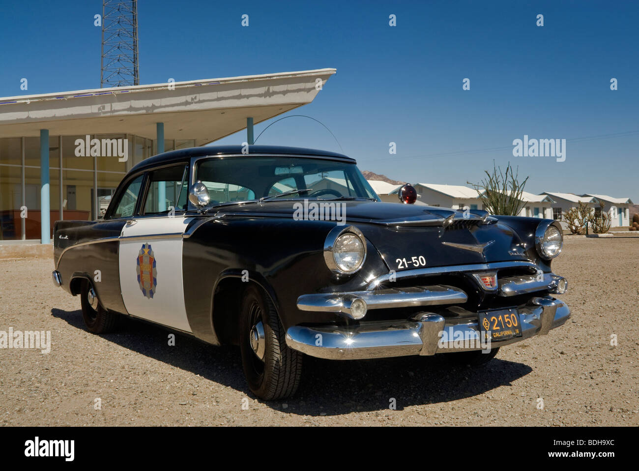 1956 Dodge Coronet police cruiser at Roys Motel and Cafe in Amboy, Mojave Trails National Monument, California, - Stock Image