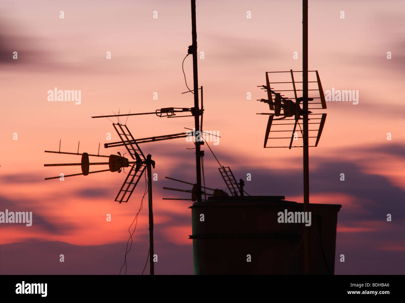 Television aerials and water tank on roof in Spain - Stock Image
