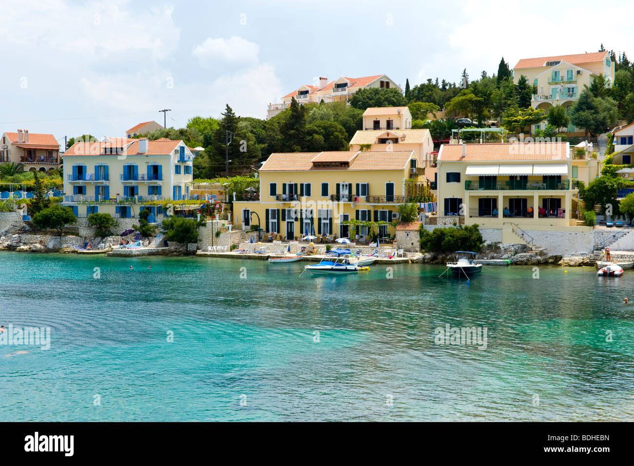 Holiday apartments overlooking the harbour in Fiskardo on the Greek Mediterranean island of Kefalonia Greece GR Stock Photo