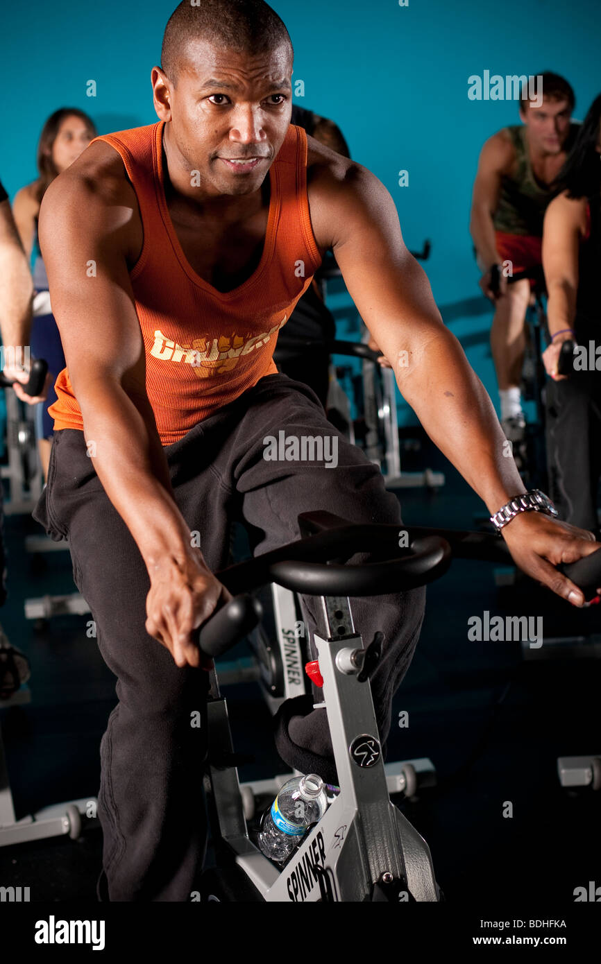A group of people workout in a Spinning class at Crunch Gym in Hollywood, California, January 21, 2008. - Stock Image