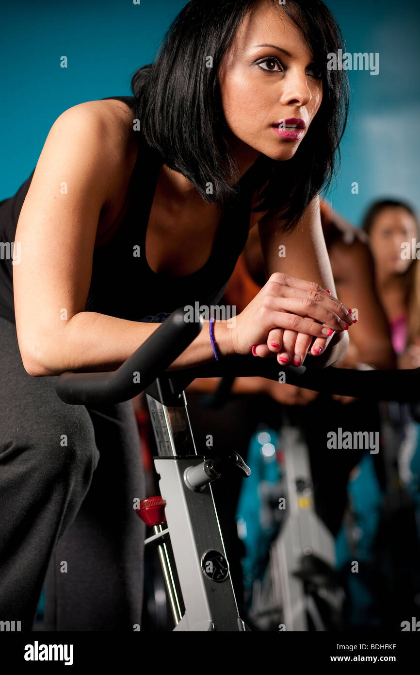 A group of people working out during a Spinning class at Crunch Gym in Hollywood, California, January 21, 2008. - Stock Image