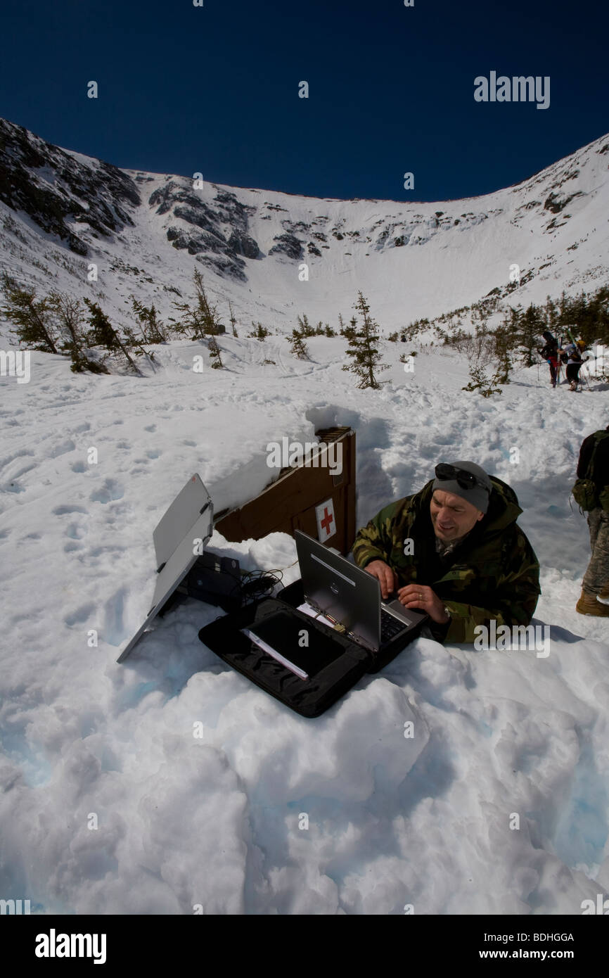 A member of the National Guard sets up a laptop with a satellite dish to transmit Inferno race times to the bottom - Stock Image