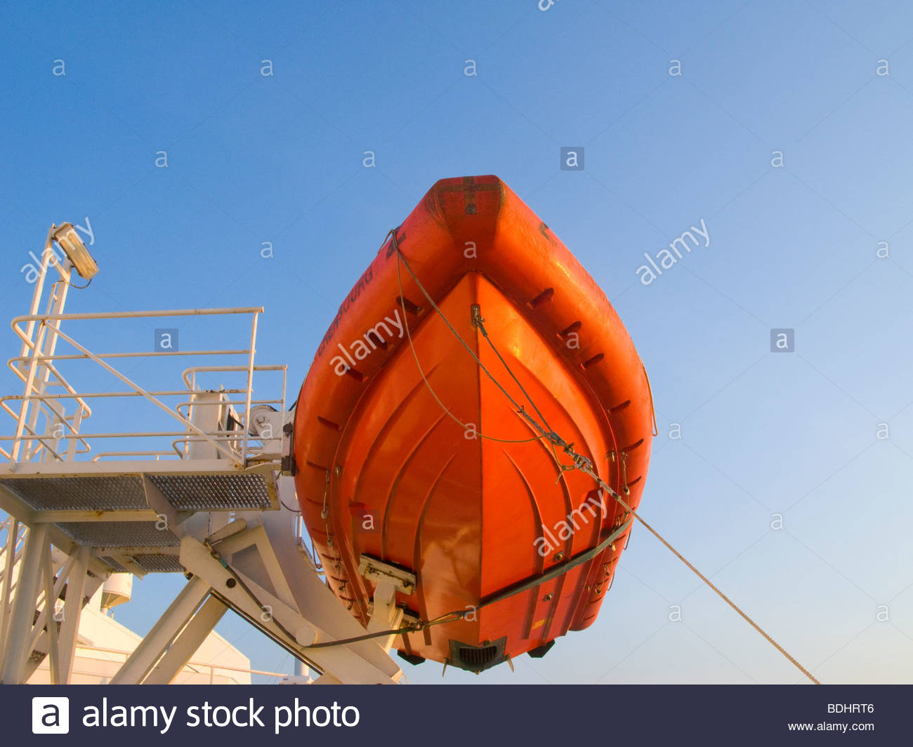 Low angle view of red lifeboat - Stock Image