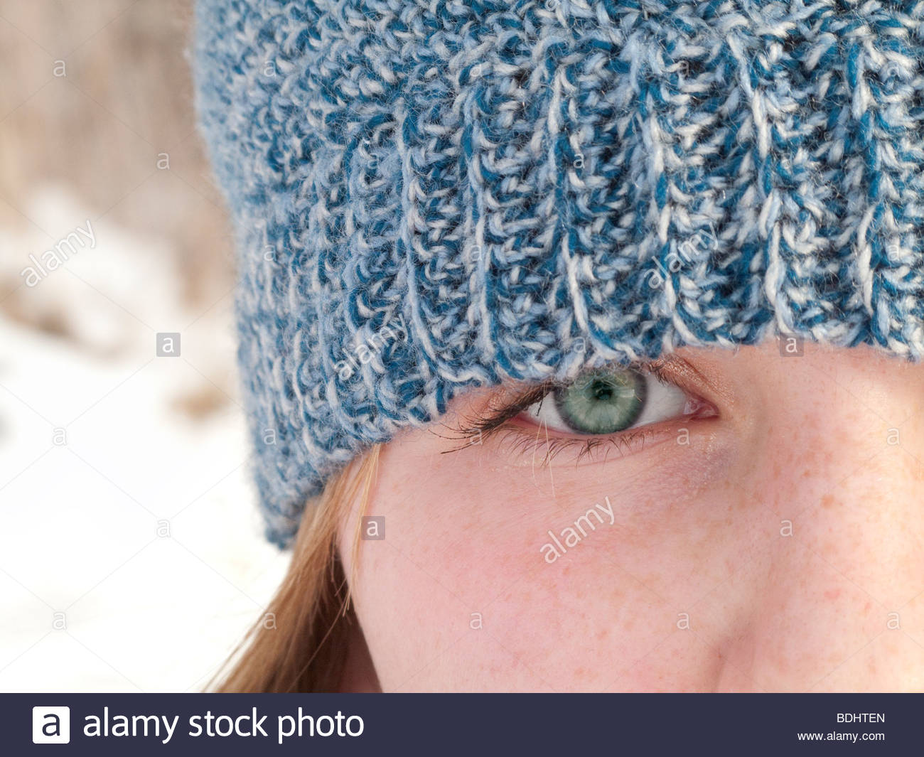 Close up of teenage girl wearing knit hat - Stock Image