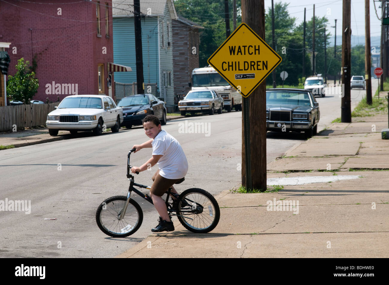 bored child bicycling - Stock Image