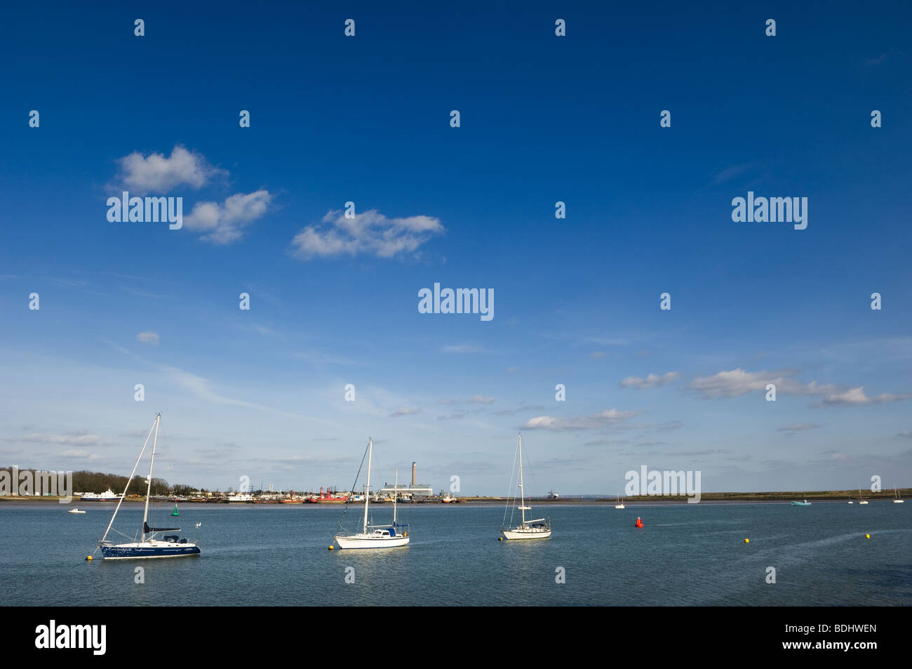 Three sailboats anchored on the Medway. - Stock Image