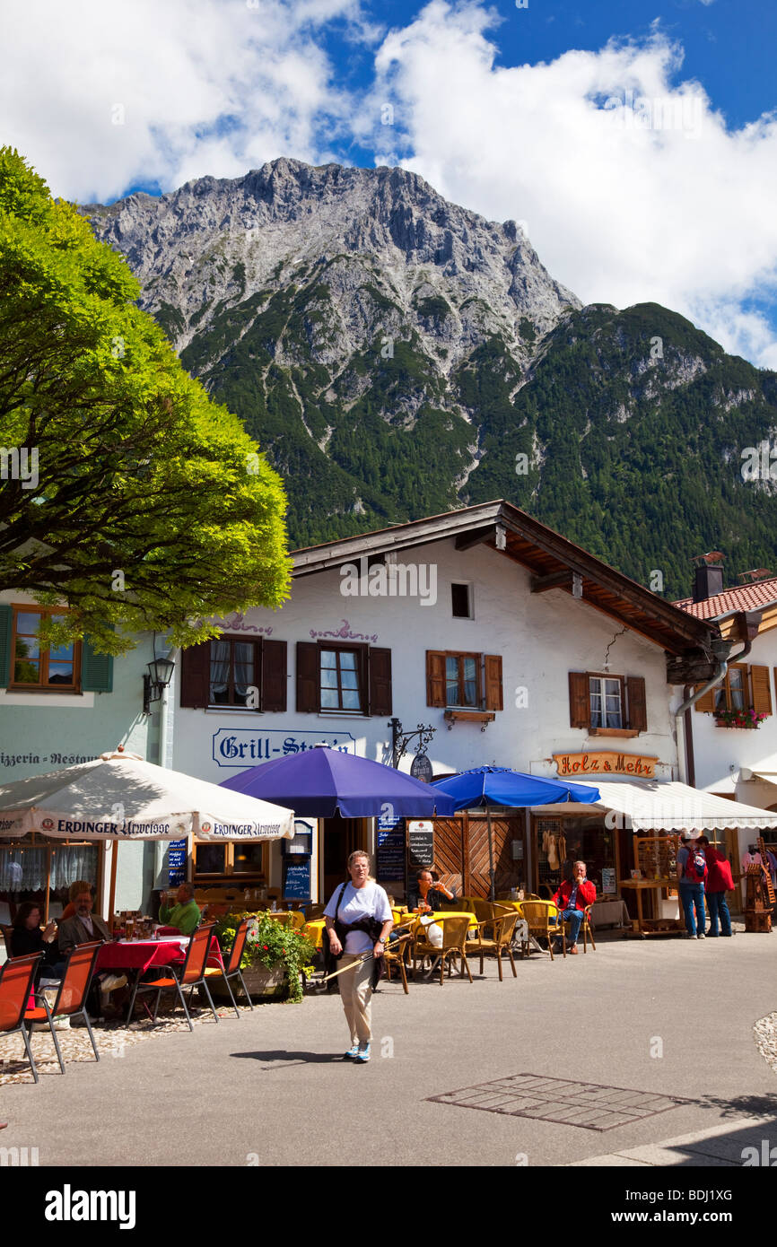 Shopping street in Mittenwald with Karwendel Mountains in the Bavarian Alps Germany Europe - Stock Image