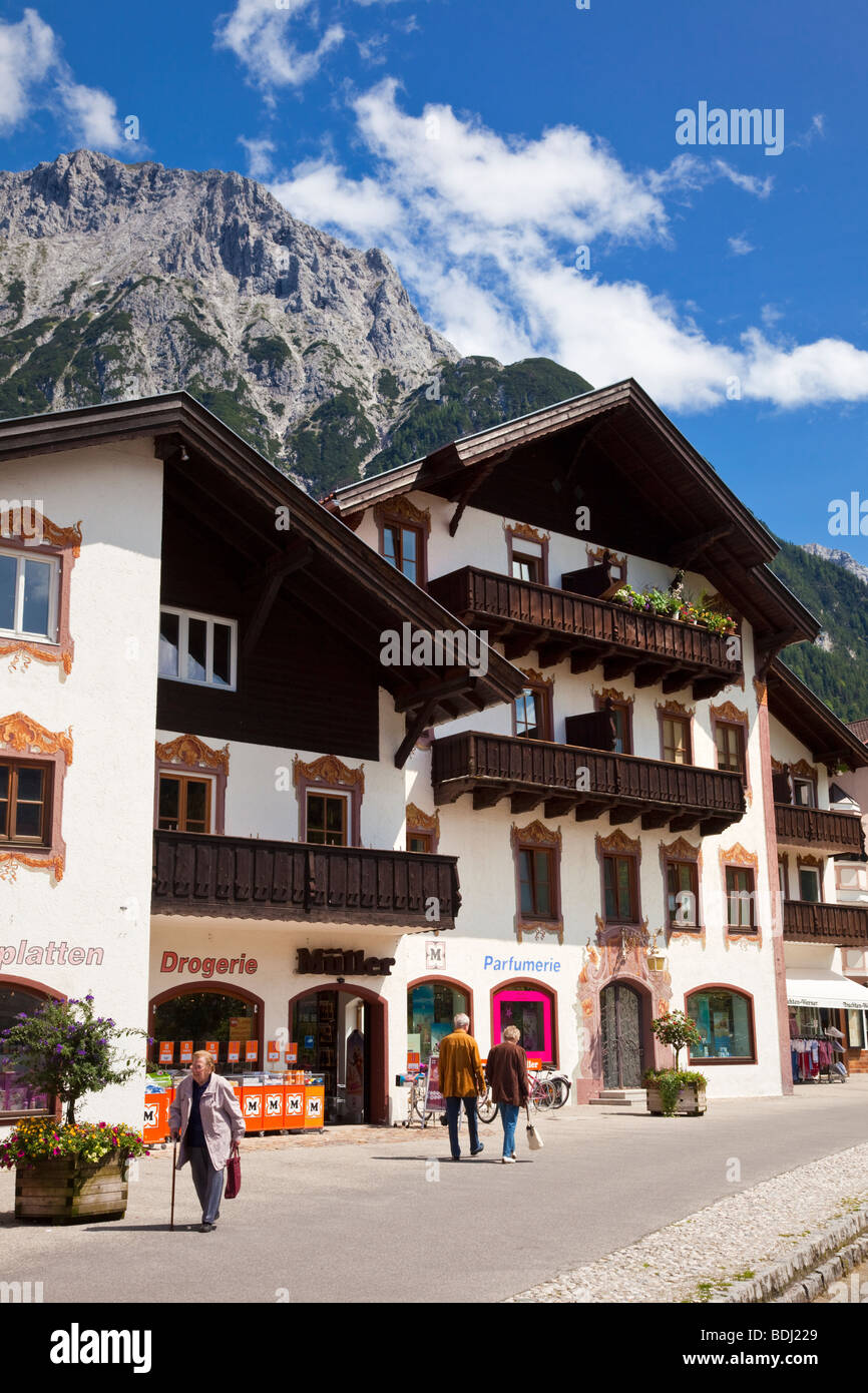 Shopping street in Mittenwald with Karwendel Mountains in the Bavarian Alps, Bavaria, Germany Europe - Stock Image