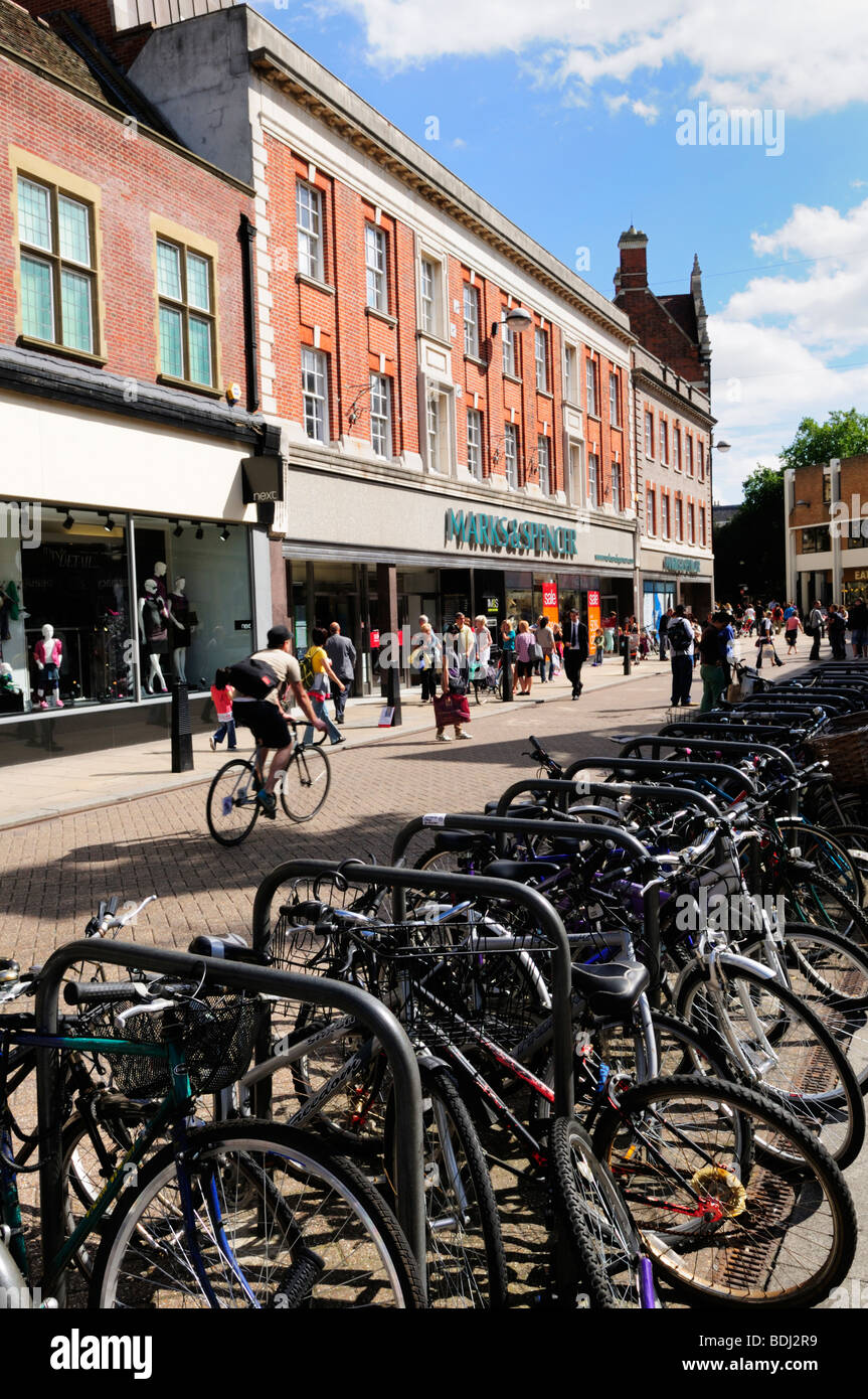 Bicycles parked in Sidney Street in the city centre, Cambridge England UK - Stock Image