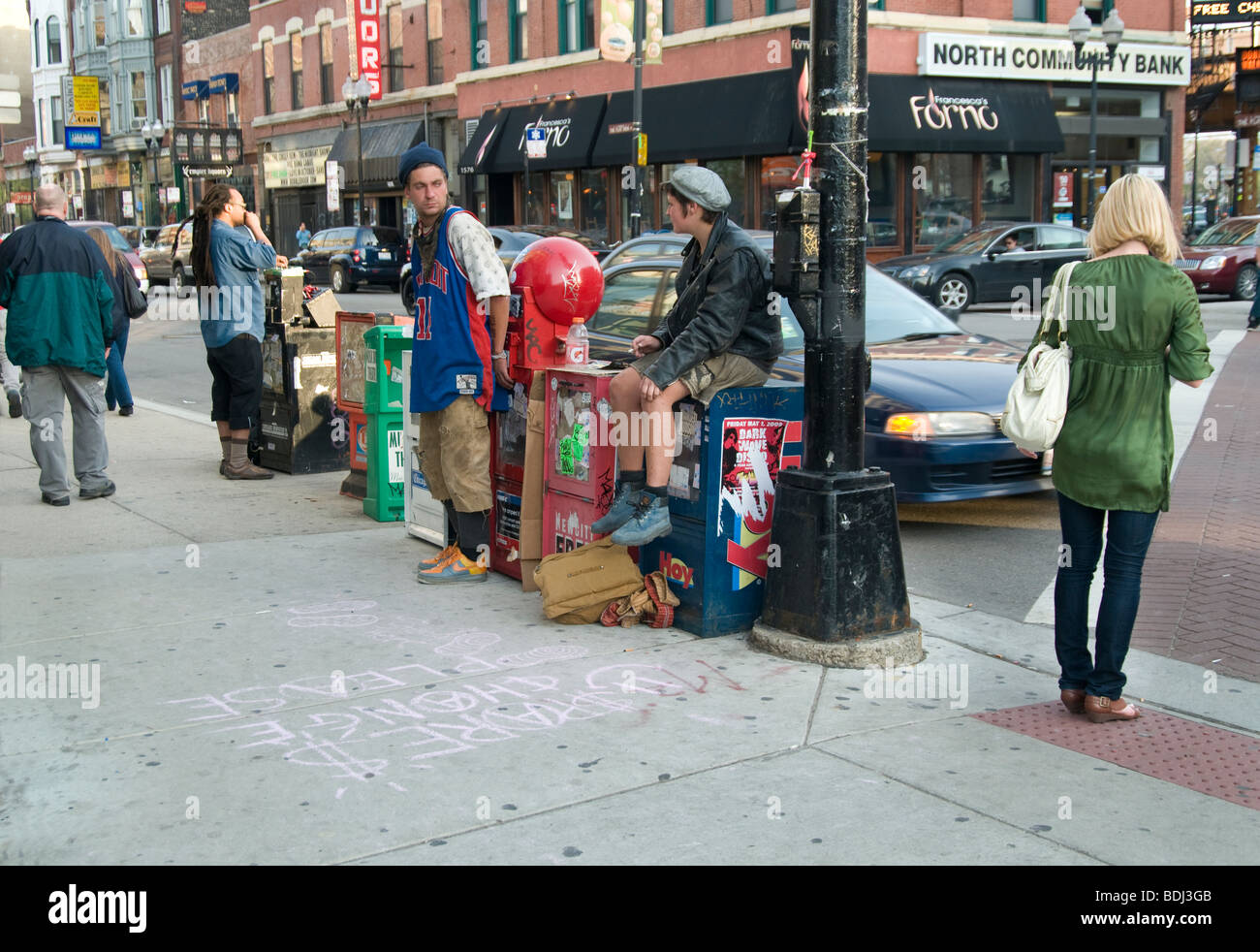 begging young people at Milwaukkee Av, Chicago, IL, US - Stock Image