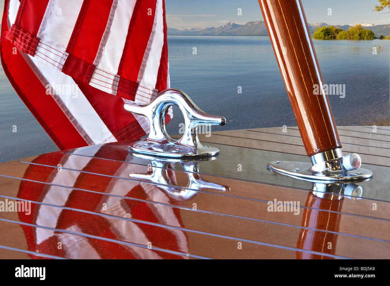 American flag and chrome fittings on Hacker craft wooden boat. Lake Tahoe. California - Stock Image