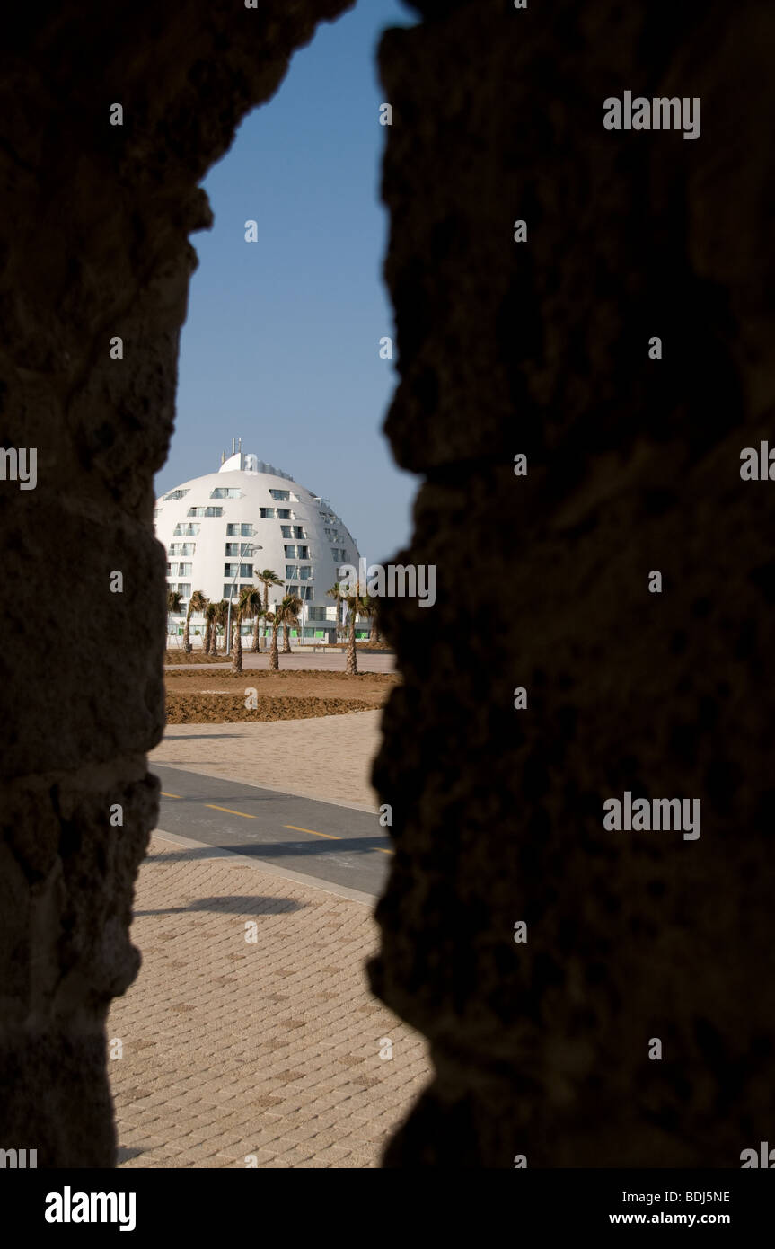 View of the Holiday Inn Hotel, Ashkelon through an ancient house's window - Stock Image