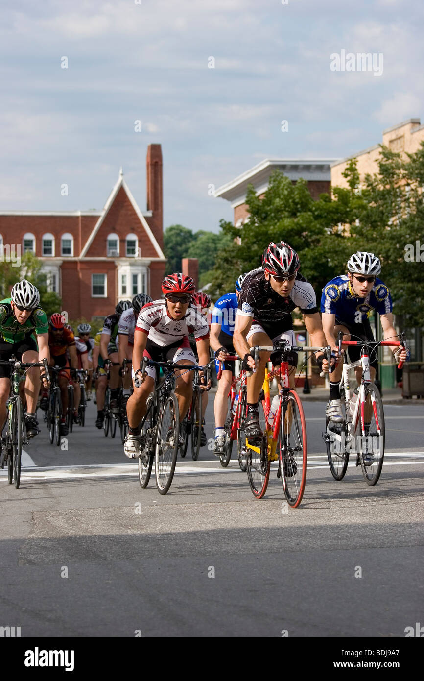 Bikers race through city streets - Stock Image