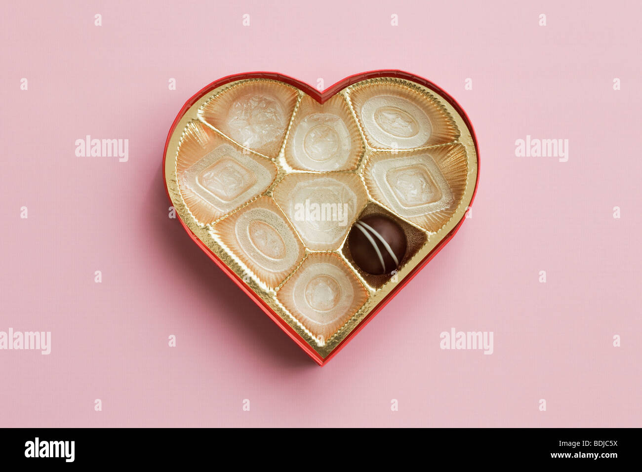 Still Life of Heart-Shaped Box of Chocolates Stock Photo